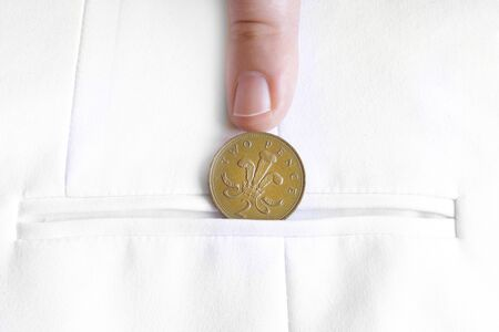 earned: saved penny is penny earned proverb representing coin in jacket pocket