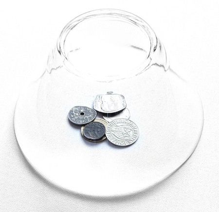 cant: you can`t always get what you want proverb representing money coins under safe cover Stock Photo