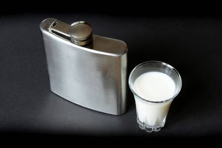cant: You can`t judge a book by its cover proverb representing, alcohol flask with natural milk inside