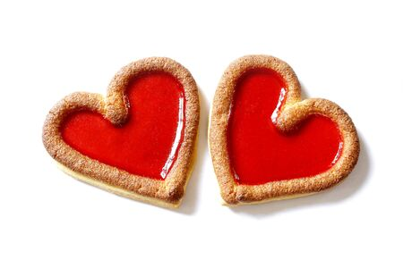 beating: two red biscuit  hearts beating together on white background
