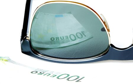 one hundred euro reflected in sunglasses of greedy man eyes Stock Photo