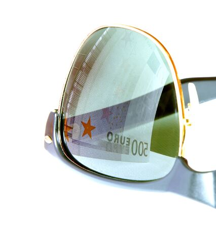 stingy: five hundred euro reflected in sunglasses of greedy man eyes Stock Photo