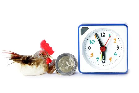 Early bird catches gets the worm proverb representing alarm clock on 6 am with bird and money Standard-Bild