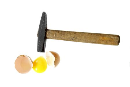 proverb: you cant make an omlet without braking a few eggs proverb hammer broken egg isolated on white background