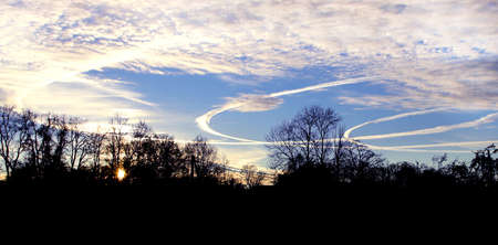 bent: three bent airplane traces on colored sky