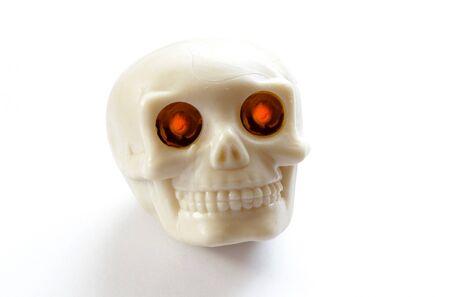 lighted: vintage human skull with burning lighted eyes on white background