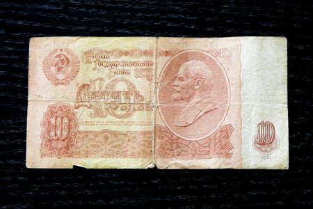creasy: money soviet ten rubles lenin banknote vintage on black background