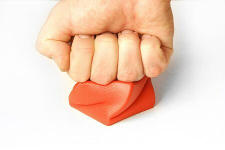 compensate: stress management arm fist hitting pressing red cube compensate rage fury angry Stock Photo