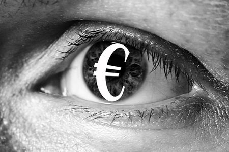 greed: euro money sign in big eye extreme greed illegal immigrant closeup Stock Photo