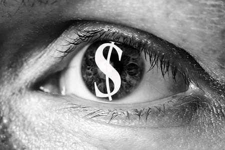 immigrant: dollar money sign in big eye extreme greed illegal immigrant closeup