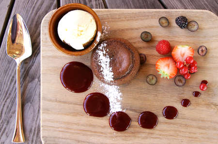vitamines: chocolatet cake with icecream and berries on board