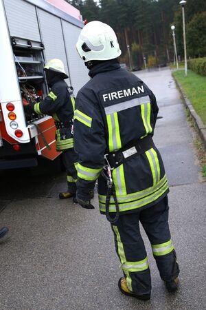 fireman working with water pump compressor