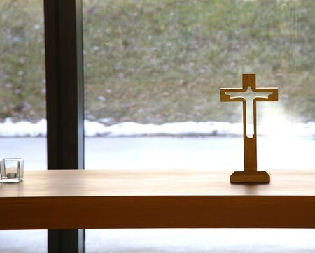 very simple wooden holy crucifix jesus christ on cross