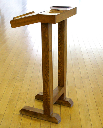 very simple wooden cathedra tribune for lecture professor