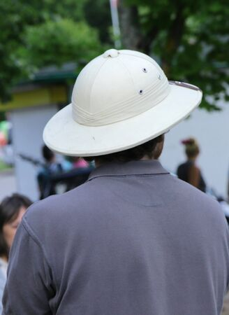 man wearing cork hat on summer day 스톡 콘텐츠