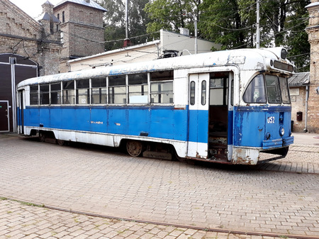 old rusted vintage blue USSR public tram in depot 에디토리얼