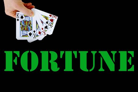 croupier player holding in hand card ace of spades four of a kind on black background fortune
