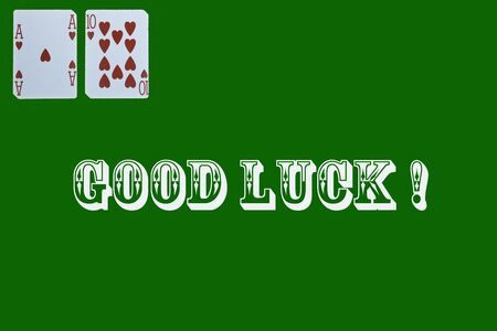 croupier player holding in hand card ace of hearts on green background