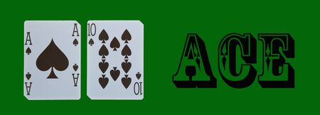 croupier player holding in hand card ace of spades on green table