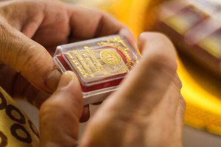 amulet: Small Buddha Amulet in the box Stock Photo