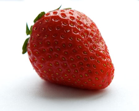 photo of object s: One single isolated fresh red strawberry in white grey background close up Stock Photo