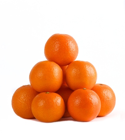 Mandarin isolated on white background, pyramid of mandarins on white background, stack of mandarins  Conceptual photo  Exotic tropical fruit photo