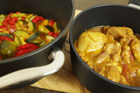 Chicken Curry with vegetables on the table. Closeup Standard-Bild
