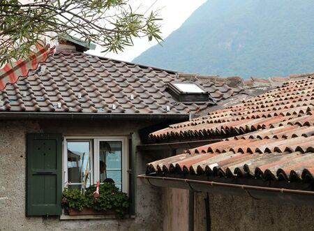 typical: Typical old house and roof in Gandria, Switzerland Editorial