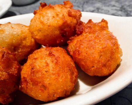 delectable: Hushpuppies are made of cornmeal. A typical Southern side dish.