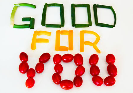 Good for You sign  scallions, yellow pepper, grape tomatoes photo