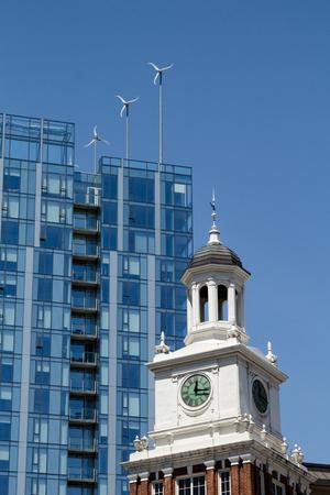 Wind turbines on modern building in Portland, OR behind old Telegram Building