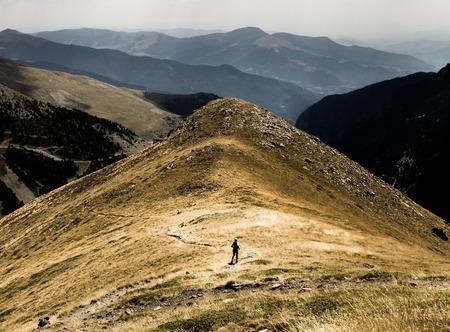 A man runs along a path in the Pyrenees. Stok Fotoğraf