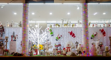 Shop Window with Christmas Decorations and Toys. Snowman, Rudolph, Santa Claus, Christmas Tree.