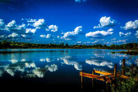 Lake acute Brazil hill landscape nature day beautiful sunshine. Stock Photo
