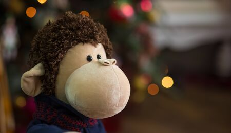 christmas symbol: the toy monkey in the Christmas decorations