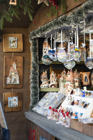 Handmade Christmas decoration on a christmas market booth in meran south tyrol italy, glass balls and objects, small bells an houses out of porcelain