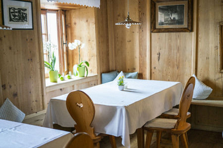 empty table with no decoration in a traditional Tyrolean mountain restaurant in austria