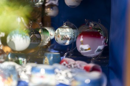 Handmade christmas balls with beautiful colors made out of glass on the christmas market of merano in south tyrol during daylight