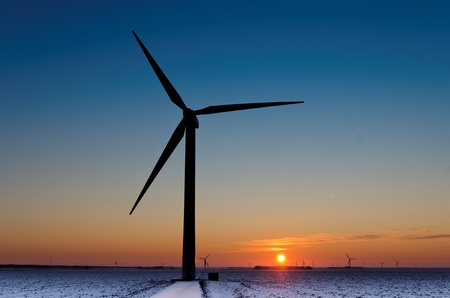 stetting: Silhouette of a wind turbine during a wintry sunset