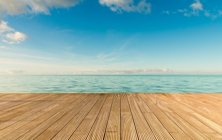 old pier: Beautiful seascape with empty wooden pier giving a warm relaxing feeling Stock Photo