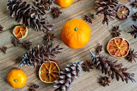 Fruit and pine cones on a wooden table
