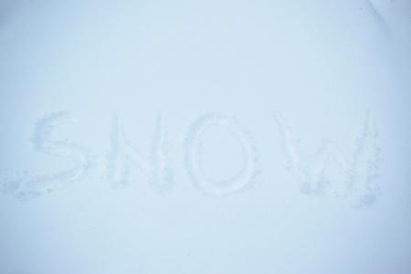 Closeup of the word 'snow' written in snow Banco de Imagens - 120588434
