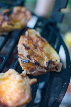 fried chicken thigh on the grill 스톡 콘텐츠