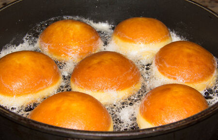 fasching: Baking Donuts In A Pan Stock Photo