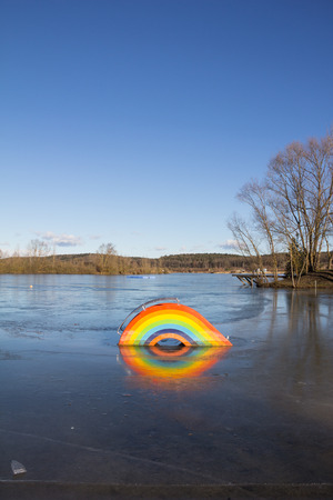 frozen lake: Frozen Rainbow Village At Lake Kings Stock Photo