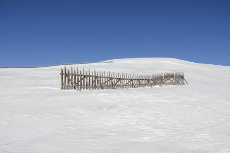 Fence On Snowy Mountain