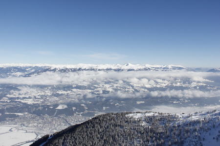 View From Top Of Gold Corner 2142m Spittal Carinthia Austria Down Into The Valley In Winter Stock Photo
