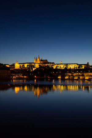 View To Hradschin Castle, St. Vitus Cathedral And Charles Bridge In Prague By Night Stock Photo