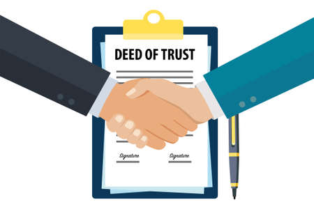 Businessman handshake after signing deed of trust document
