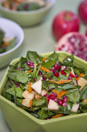 Delicious healthy mixed salad with pomegranate